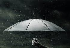 Umbrella under raindrops Royalty Free Stock Images