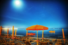 Umbrella under a starry sky in Alghero Royalty Free Stock Images