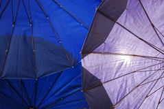 Umbrella underneath. Underneath blue and purple Umbrella under the sun royalty free stock images
