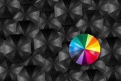 Umbrella unique concept. Rainbow umbrella in mass of black umbrellas Stock Photography