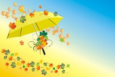 Umbrella and varicolored leaves Royalty Free Stock Photography