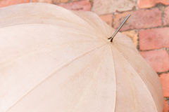Umbrella. Vintage umbrella in rain in front of wall Royalty Free Stock Images