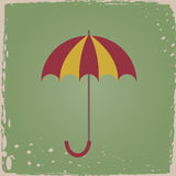 Umbrella. In vintage style on a green background Stock Image