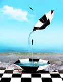 Umbrella and water. A checkered umbrella pours water into another umbrella filled with water and lotus flowers as the tide comes over a checkered floor Royalty Free Stock Photography