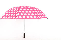 Umbrella on White Isolated Background. Pink Umbrella With White Spots on White Isolated Background Stock Images