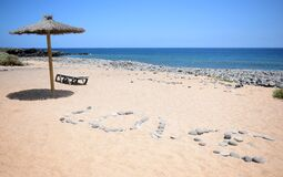 Free Umbrella With The Word Love Made Of Stones Near Beach In Tenerife. Royalty Free Stock Photos - 187283858
