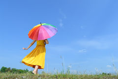 Umbrella woman and blue sky Stock Photos