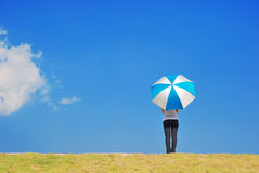 Umbrella woman and blue sky Royalty Free Stock Photography