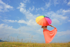 Umbrella woman and blue sky Royalty Free Stock Photos