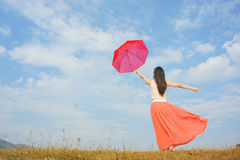 Umbrella woman and blue sky Royalty Free Stock Images