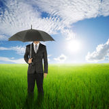 Umbrella woman standing to sun sky in grassland with umbrella Stock Photography
