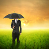 Umbrella woman standing to sunset in grassland with umbrella Royalty Free Stock Photo