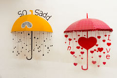 Umbrella. Yellow and red Umbrella decorate on wall royalty free stock image