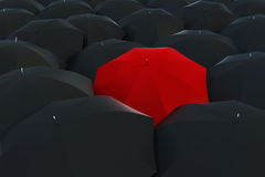 Umbrella01. A single red umbrella in an ocean of black umbrellas Royalty Free Stock Images