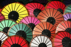 Umbrellas. Many colored paper umbrellas in a market in lung prabang in laos Stock Photo