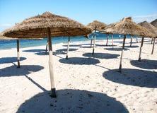 Umbrellas. On the beach Stock Photography