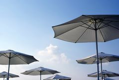 Umbrellas. In a zone of rest Royalty Free Stock Photography