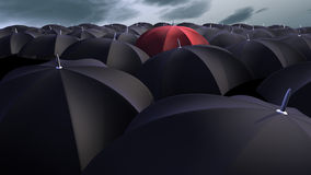 Umbrellas. 3d image of a red umbrella between a lot of  black umbrellas Stock Photos