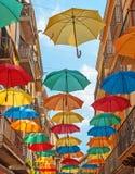 Umbrellas adorn the city street. Bright, colorful umbrellas adorn the city street royalty free stock images