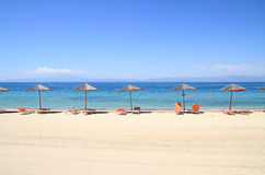 Free Umbrellas And Recliners By The Sea Stock Photos - 31291863