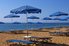 Umbrellas And Sunbeds. Stock Photography
