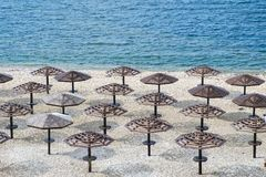 Umbrellas awnings on the winter beach. In russia Stock Image