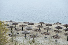 Umbrellas awnings on the winter beach. In russia Stock Photos