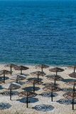 Umbrellas awnings on the winter beach. In russia Royalty Free Stock Photography