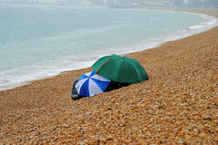 Umbrellas on the Beach Stock Photography