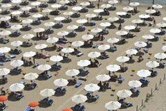 Umbrellas on a beach. High season on a beach near Sperlonga, Italy Royalty Free Stock Images