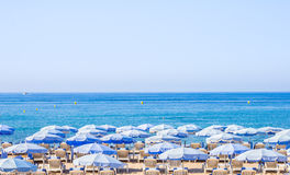 Umbrellas on a beach in Cannes, France Royalty Free Stock Photography