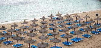 Umbrellas and beach chairs at the beach of Portals Nous.  Stock Images