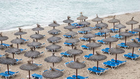 Umbrellas and beach chairs at the beach of Portals Nous.  Royalty Free Stock Photography
