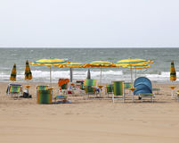 Umbrellas and beach chairs in the summer resort for holidaymaker Stock Images
