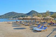Umbrellas in a beach in Corfu island Greece. Great relaxation area in a beach in Corfu island - travel in Europe Royalty Free Stock Photo