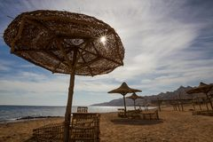 Umbrellas on the beach at Dahab Royalty Free Stock Image