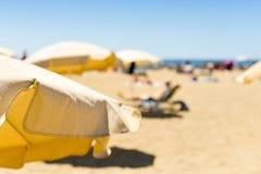 Umbrellas in a beach in the Mediterranean sea Royalty Free Stock Image