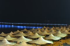 Umbrellas on beach at night Royalty Free Stock Images