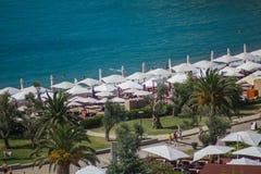 Umbrellas on the beach. The beach umbrellas opened many visitors Royalty Free Stock Photo