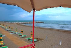 Umbrellas on the beach without people from the lifeguard tower. Many umbrellas on the beach without people in summer from the lifeguard watching tower royalty free stock image