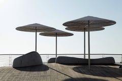 Umbrellas on beach promenade of Tel Aviv, Israel Stock Photos