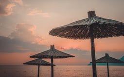 Umbrellas on the beach. Retro style filter Royalty Free Stock Image