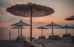 Umbrellas on the beach. Retro style filter Stock Photos