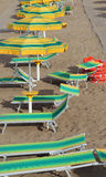 Umbrellas in beach seen from above in summer Stock Images