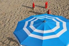 Umbrellas in beach seen from above in summer Stock Photos
