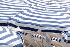 Umbrellas on the beach Stock Images