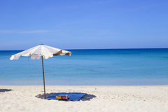 Umbrellas in a beautiful day on Surin beach in Phuket Thailand Stock Photo