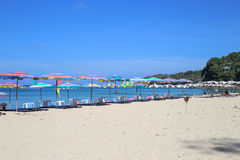 Umbrellas in a beautiful day on Surin beach in Phuket Thailand Royalty Free Stock Photography