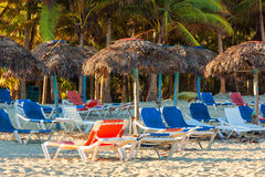 Umbrellas and bech beds on Varadero in Cuba Royalty Free Stock Photography
