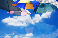 Umbrellas on blue sky and clouds background with reflect Stock Photo